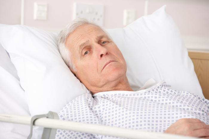 depressed-man-in-hospital-bed